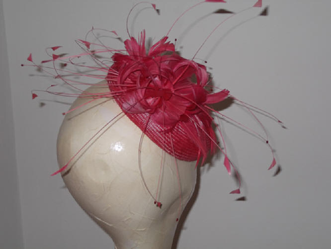 Designer Millinery by Rachel Wykes Events fascinator Coral Pink