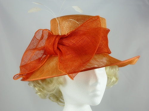 25703def Price: £22.99 plus delivery. Product has been sold. 1 / 4. First Avenue Orange  Wedding Hat